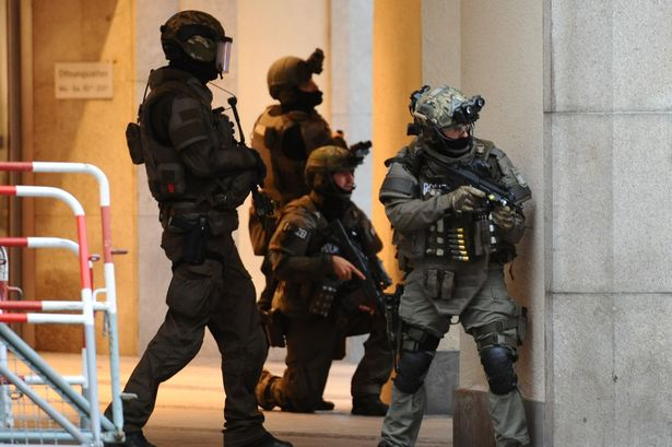 police-secures-teh-area-of-a-subway-station-karlsplatz-stachus-near-a-shopping-mall